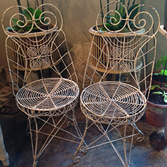 A pair of nineteenth century white wire work conservatory chairs.