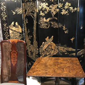 A stunning C19 th Chinese black and gilt lacquered screen