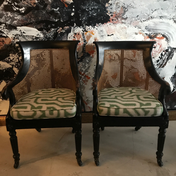 An excellent pair of Regency ebonised bergere chairs