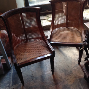 Pair of Regency Gillows Bergere chairs