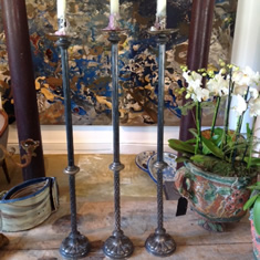 Three elegant silver plated arts and crafts candlesticks